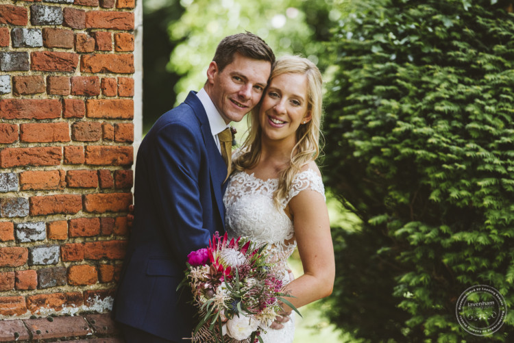 Lovely red-brick textures and green leafyness. A really relaxed and happy wedding photo