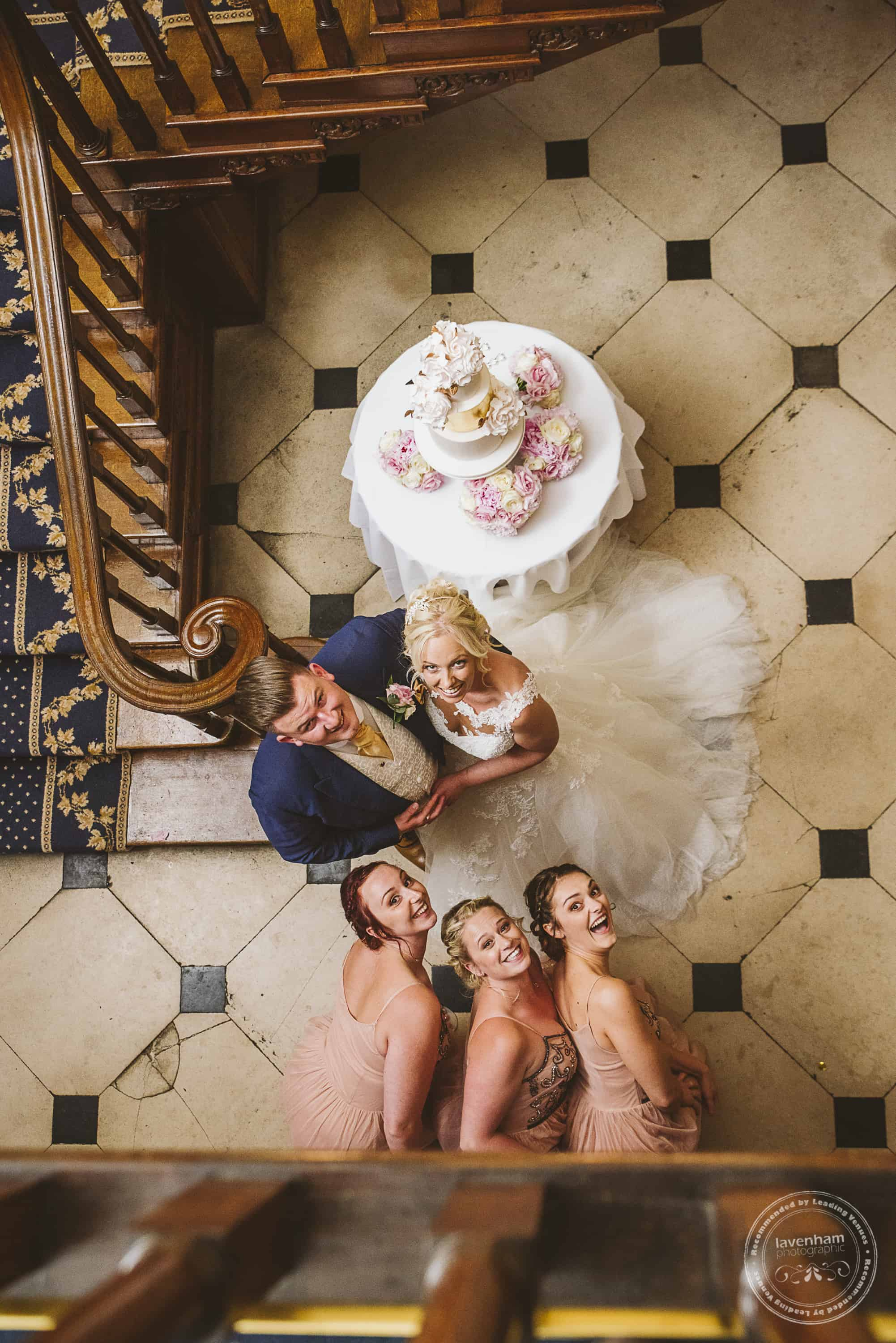 Bridesmaids photobomb a photo from the top of the stairs at Gosfield Hall!