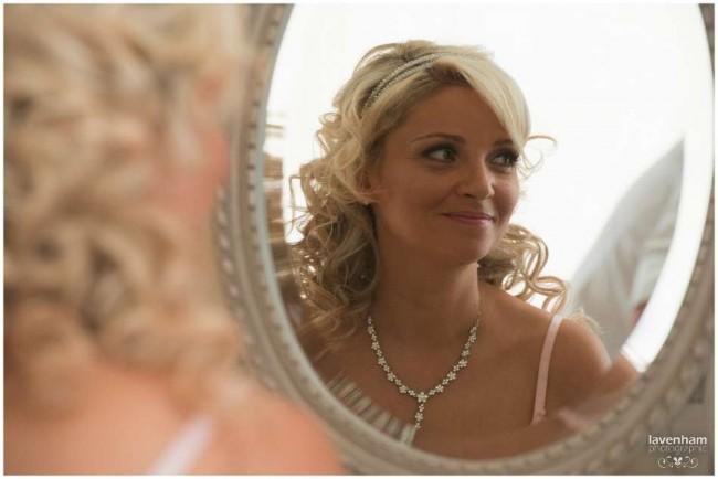 Bride's in mirror, preparation photography at The Mill Hotel, Sudbury