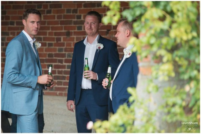 casual photography of groom with guests
