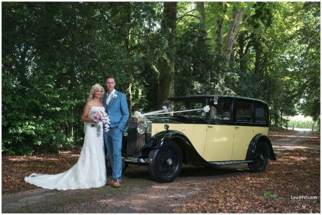 Bride and groom with wedding car, down leafy driveway at Smeetham, Hall, creative remote lighting