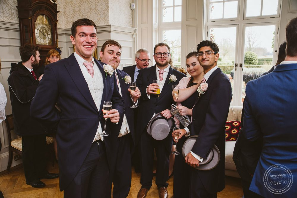 Guests mingle at Chippenham Park Wedding