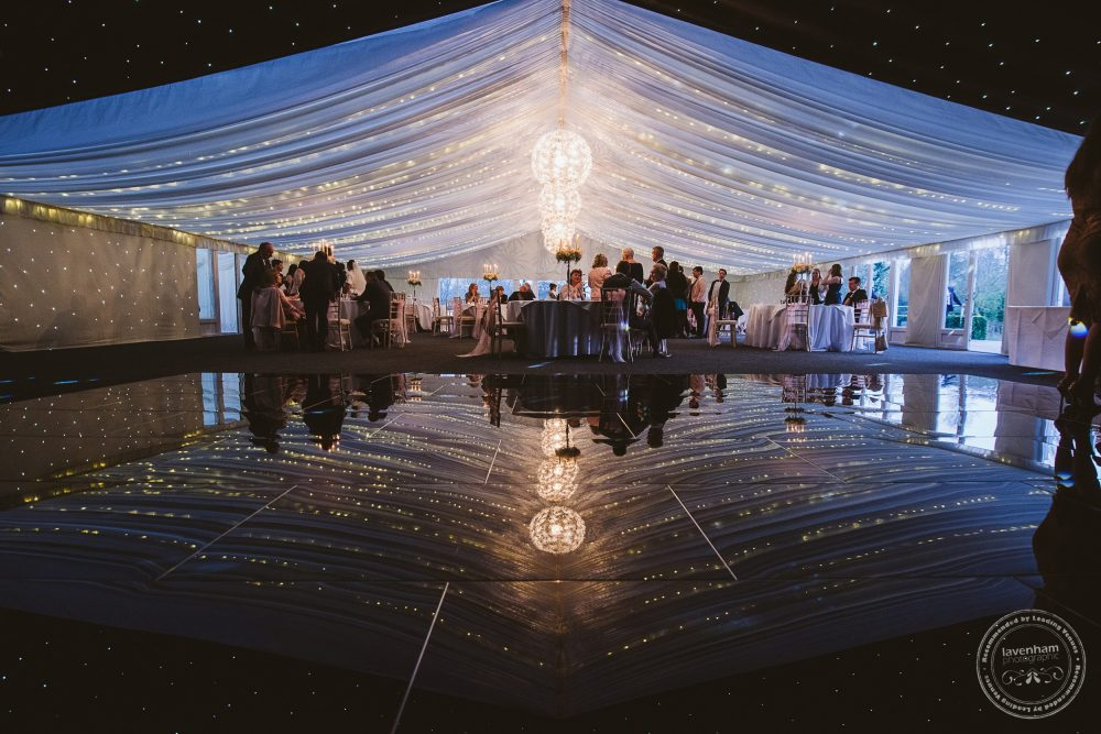 The evening reception photographed in the reflection of the dancefloor
