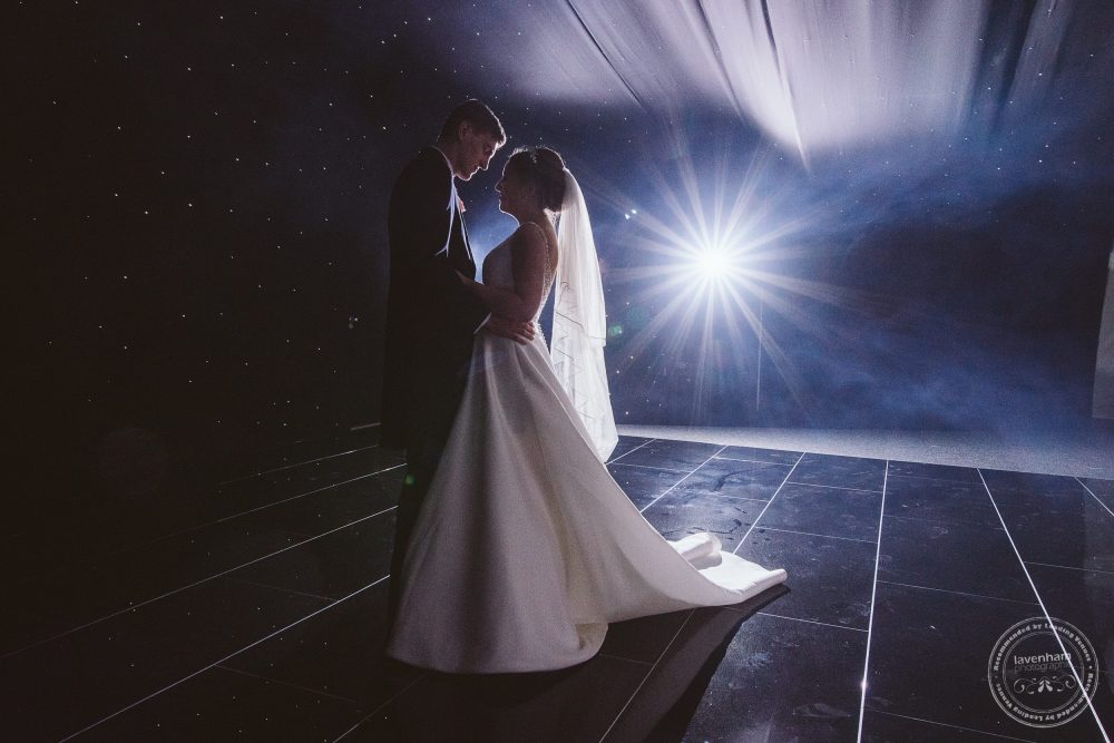The first dance at Chippenham Park, The bride and groom with large starburst from a flash