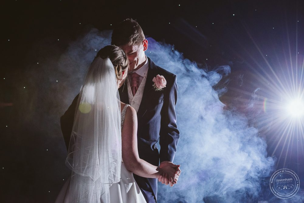 The first dance photographed at Chippenham Park wedding. Smoke machine creating dramatic clouds