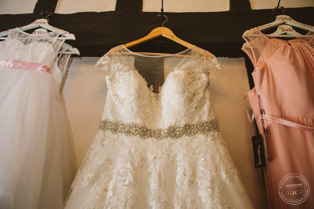 Wedding dress hanging, with bridesmaids dresses