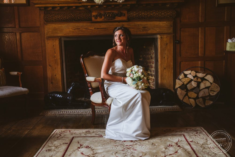 Photography of Bride sitting in oak panelled room in Leez Priory