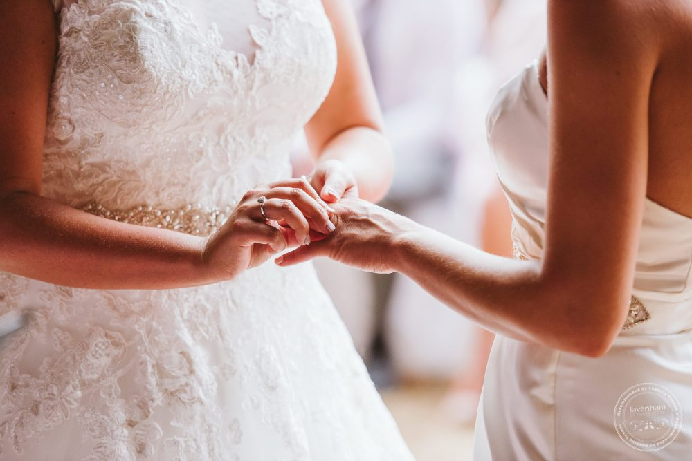 Brides exchanging rings, Leez Priory same sex wedding photography