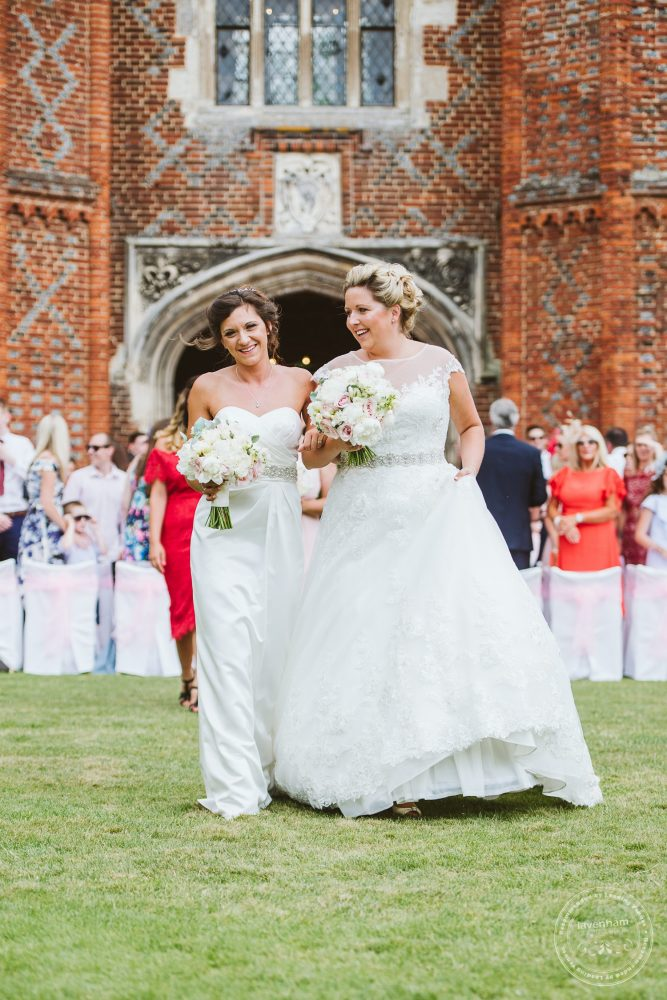 Two brides walk down the aisle married, same sex Leez Priory Wedding Photography