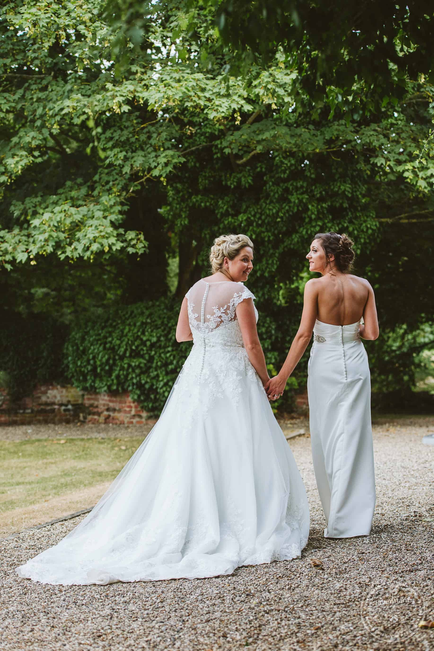 Two brides walking in the grounds at Leez Priory Gay Wedding