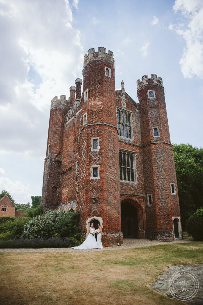 Bride and bride in front of Leez Priory's Tower