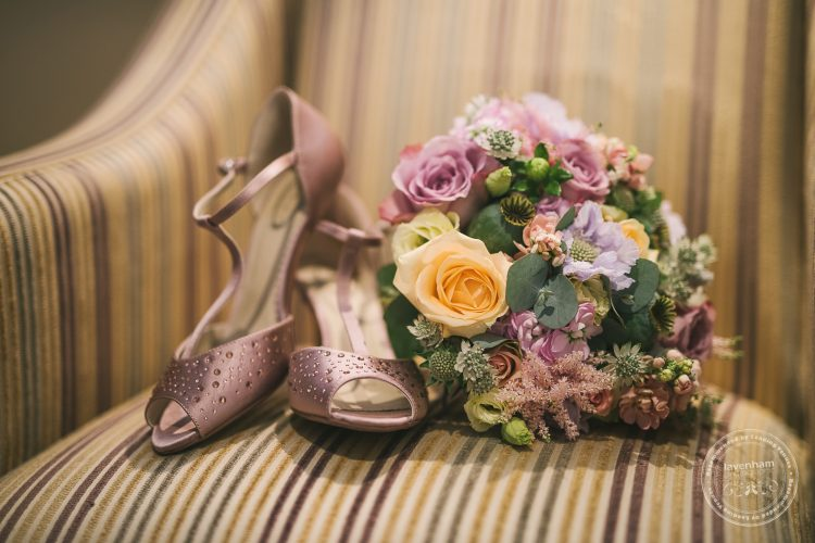 Photograph of wedding shoes with wedding bouquet