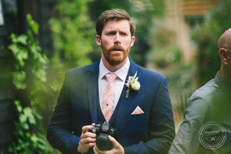 Groomsman with camera at Preston Priory wedding