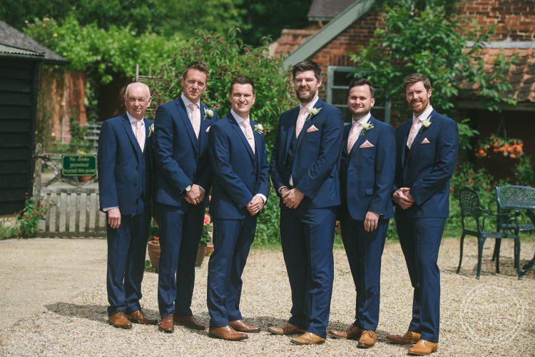 Groom with groomsmen at Preston Priory Barn