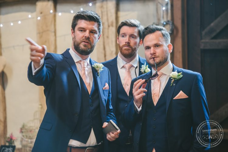 Groomsmen organising guests, wedding ceremony at Preston Priory Barn