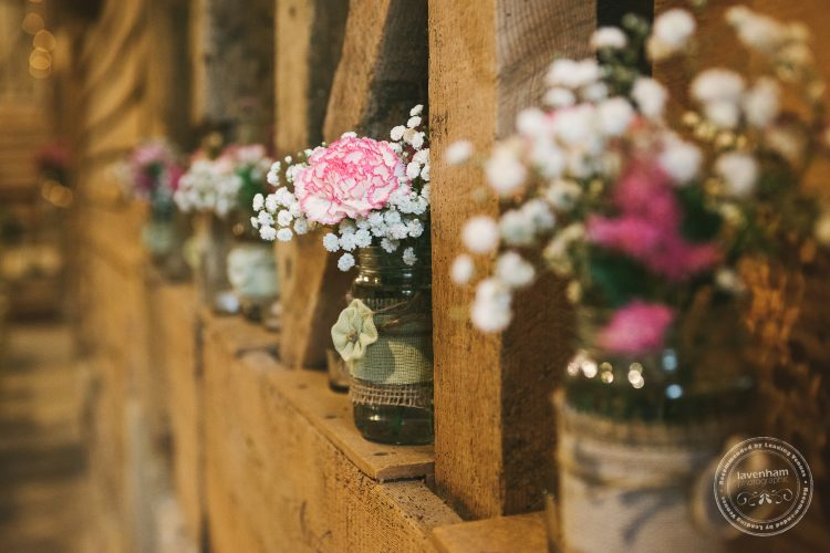 Photography of wedding details, jars of flowers wrapped in hessian