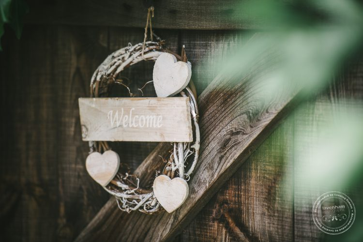 Photography of wedding details, hanging signs against wood