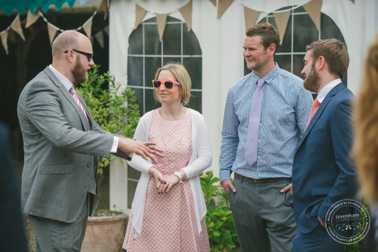 Photography of Guests chatting at Preston Priory Barn wedding