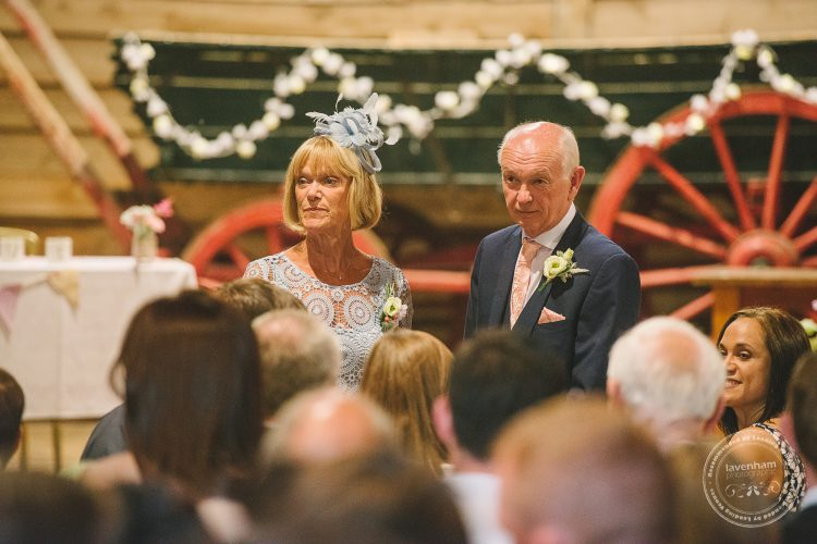 Photography of Guests chatting at Preston Priory Barn wedding ceremony