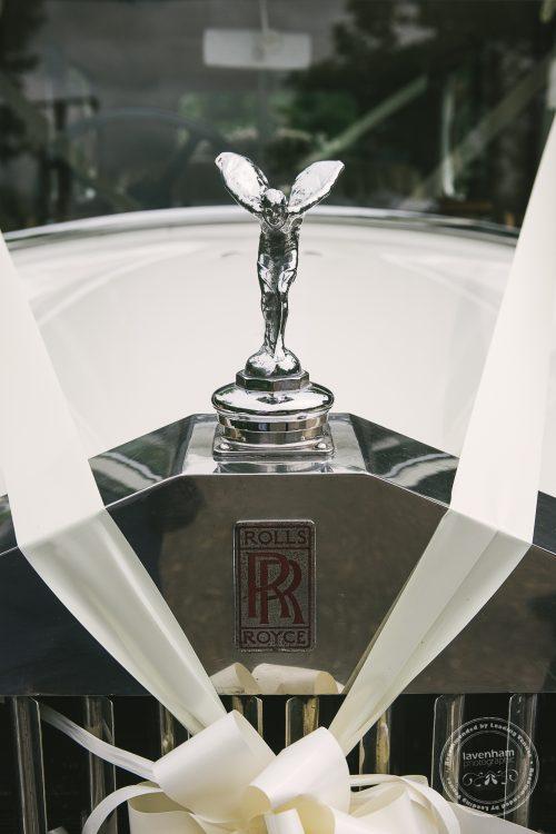 Detail photo of wedding car, Rolls Royce Spirit of ecstasy with white ribbon