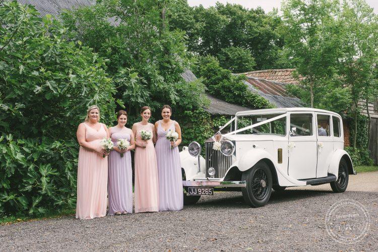 Photograph of bridemaids and Rolls Royce wedding car