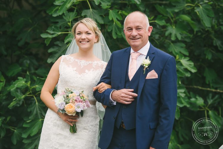 Photoghraph of Bride on Father's arm before Wedding Ceremony at Preston Priory Barn
