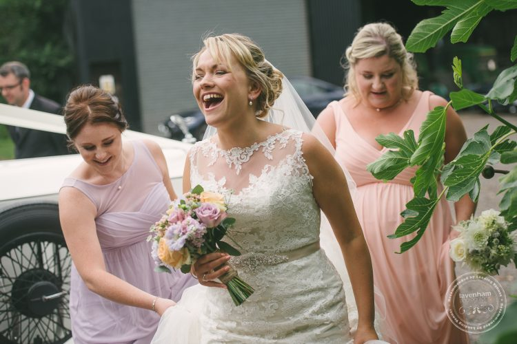 Bride Laughing, with bridesmaids, before wedding ceremony
