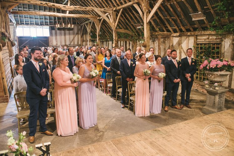 Guests watching wedding ceremony in Preston Priory Barn