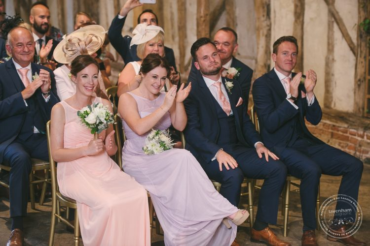 Guests clapping at wedding ceremony