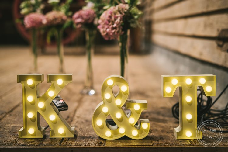 Initial Marquee Letters light up at wedding ceremony