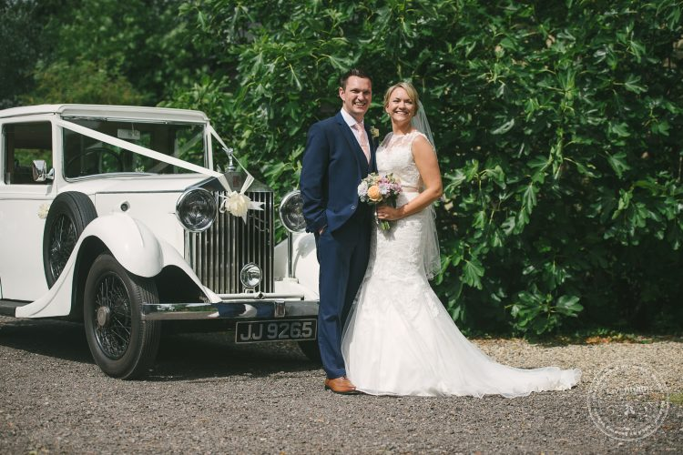 Bride and groom with classic Rolls Royce at Preston Priory Barn