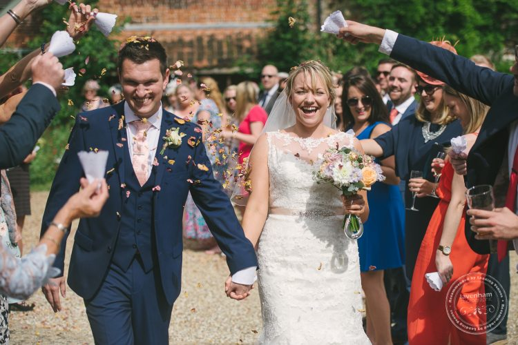Bride and groom with confetti being thrown