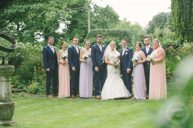 Group photograph of wedding party, bride, groom, ushers and bridesmaids at Preston Priory Barn