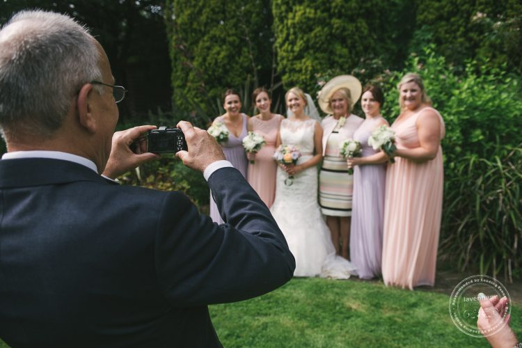 Dad takes group photo in the garden at Preston Priory Barn