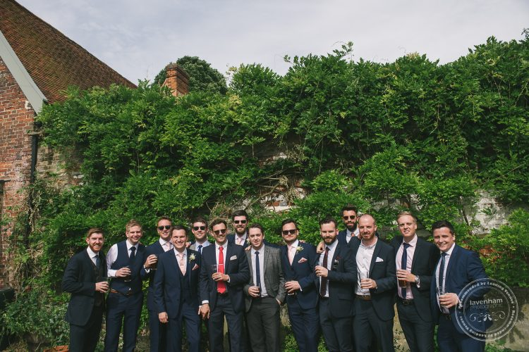 Group photo of the groom and his mates at preston Priory Barn