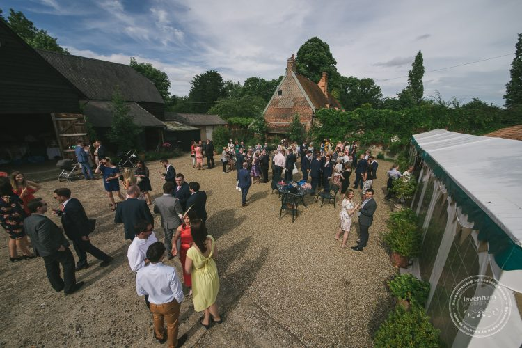 Wedding guests mingling in the courtyard
