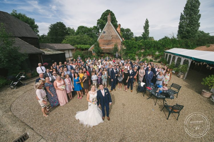 Overhead group photo of the whole wedding in the courtyard