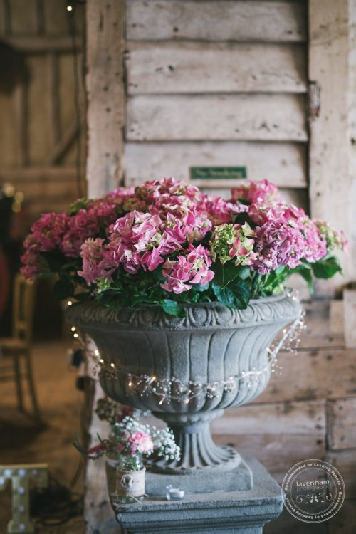Flowers in urns at Preston Priory Barn