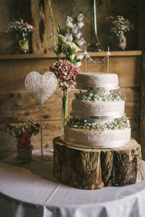 Photograph of wedding cake with lace detail and gypsophila