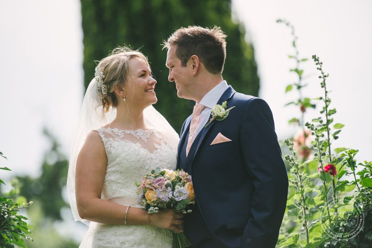 Wedding photo of Bride and groom in garden at Preston Priory Barn