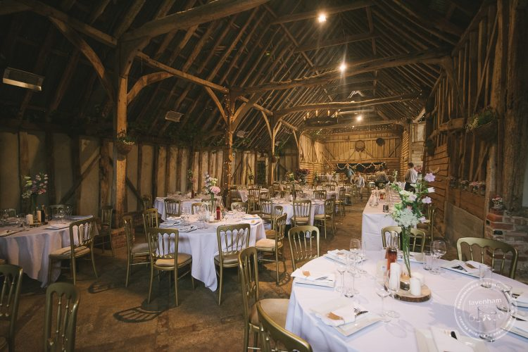 Wide photo of Preston Priory Barn set up for the wedding breakfast