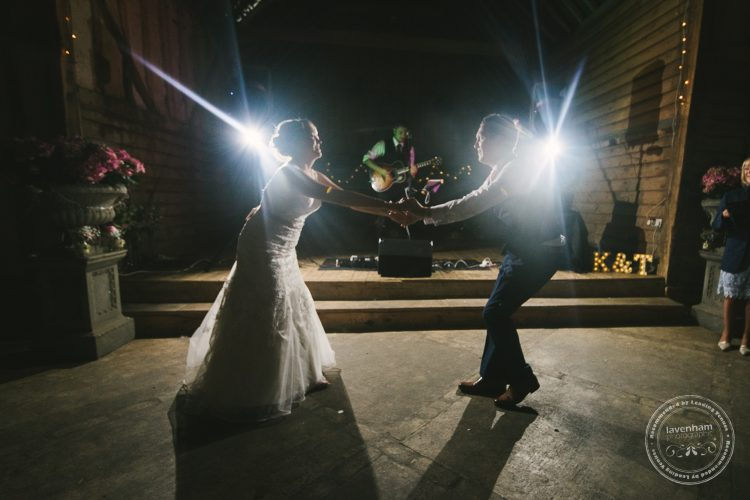 Bride and groom start the first dance at Preston Prioy Barn, with musician Jayson Norris playing