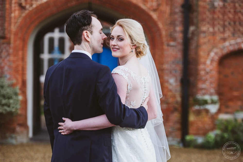 Bride and groom in the grounds at Gosfield Hall wedding