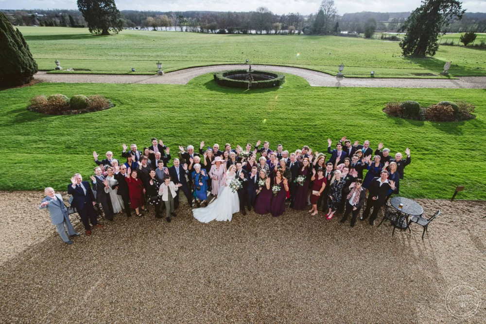 Large group photo of the whole wedding at Gosfield Hall