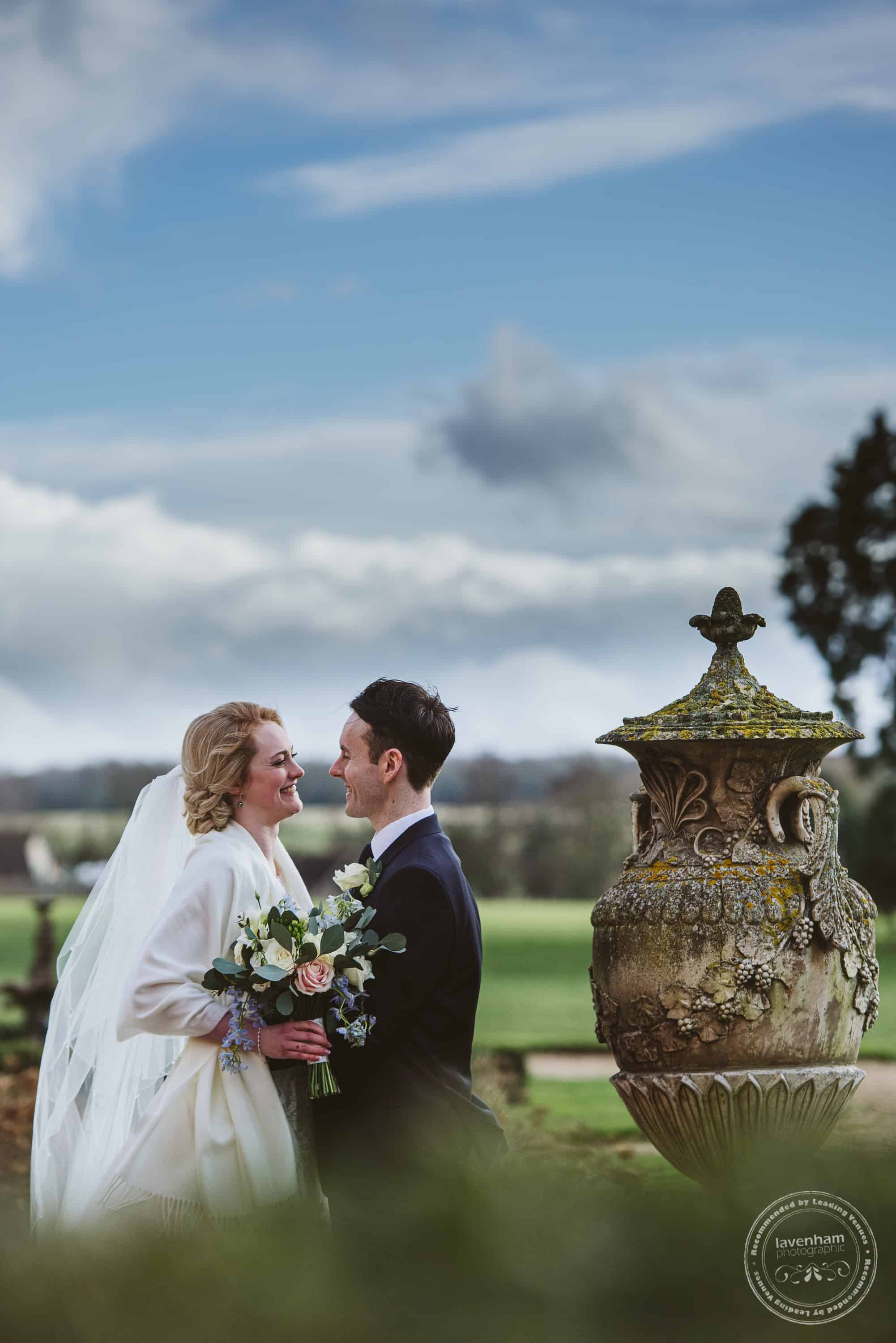 Wedding photography by the stone urn at Gosfield. Adding soft, out-of-focus edges to photos can create a nice look!