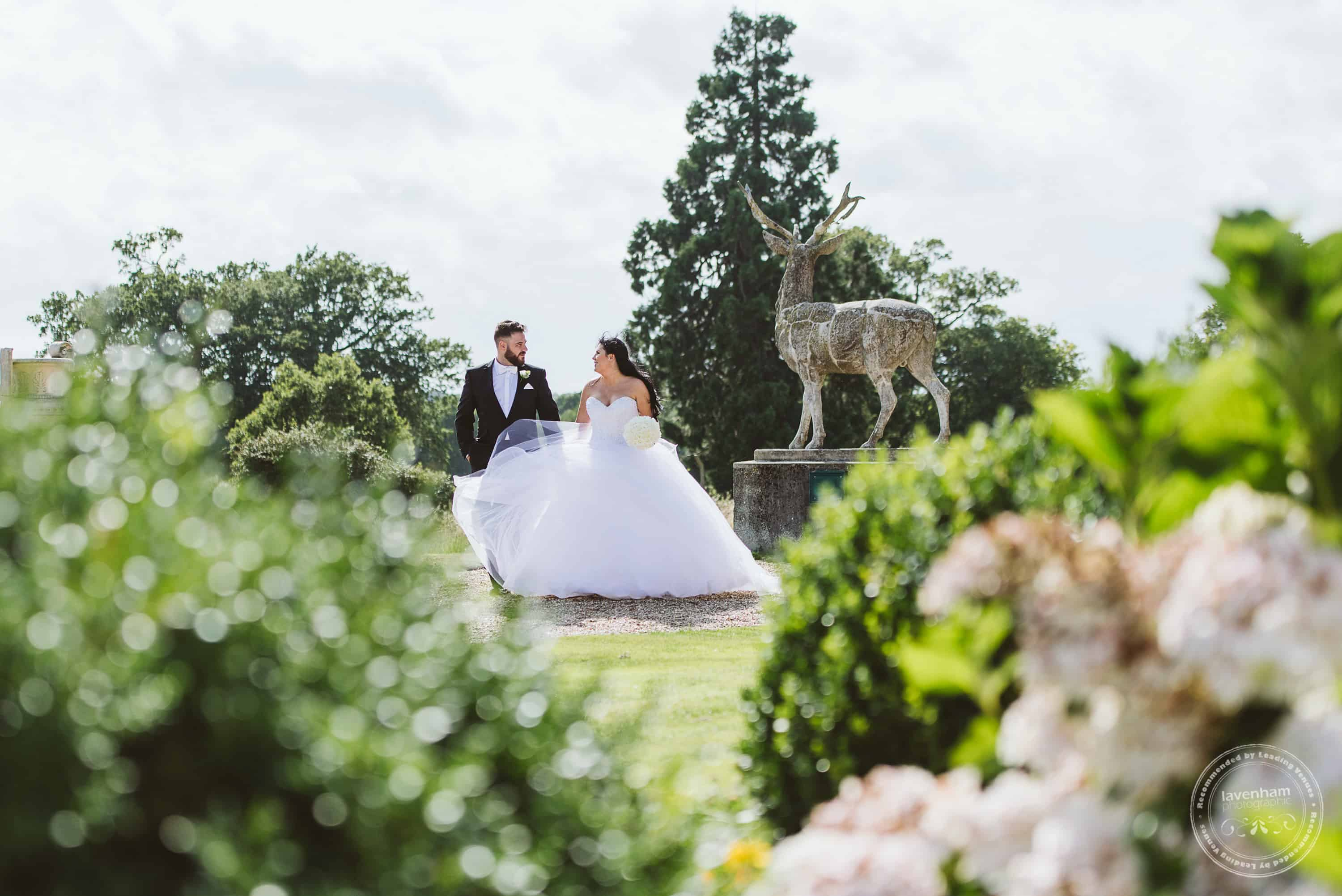 Bride and groom, walking in the grounds at Gosfield Hall