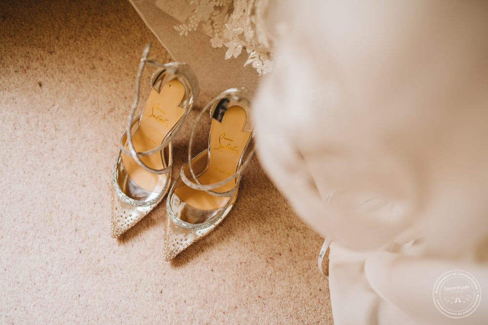 Shiny silver wedding shoes with the bride's wedding dress