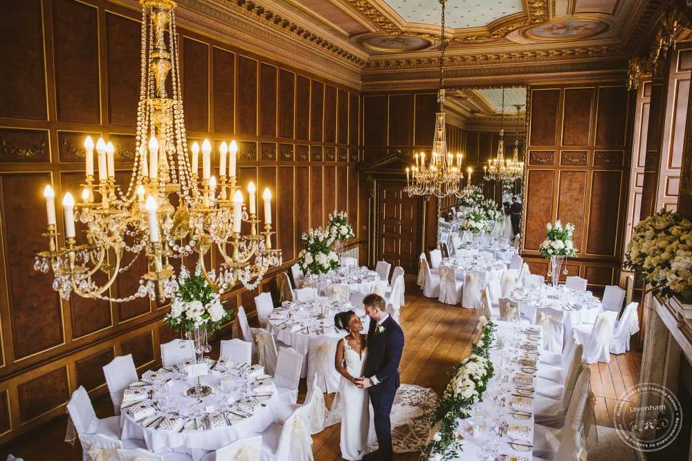 The bride and groom standing in Gosfield Hall's Ballroom ready for their wedding breakfast