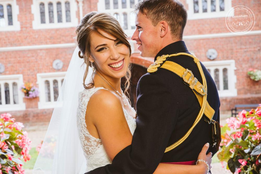 Bride smiles to camera in wedding photograph