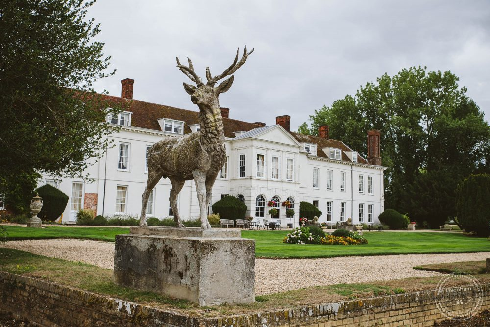 Gosfield Hall with stag statue on the morning of the wedding